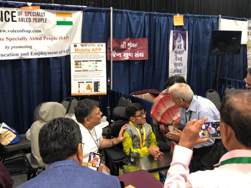 Sparsh Shah at VOSAP Booth, inspiring Jain community leaders